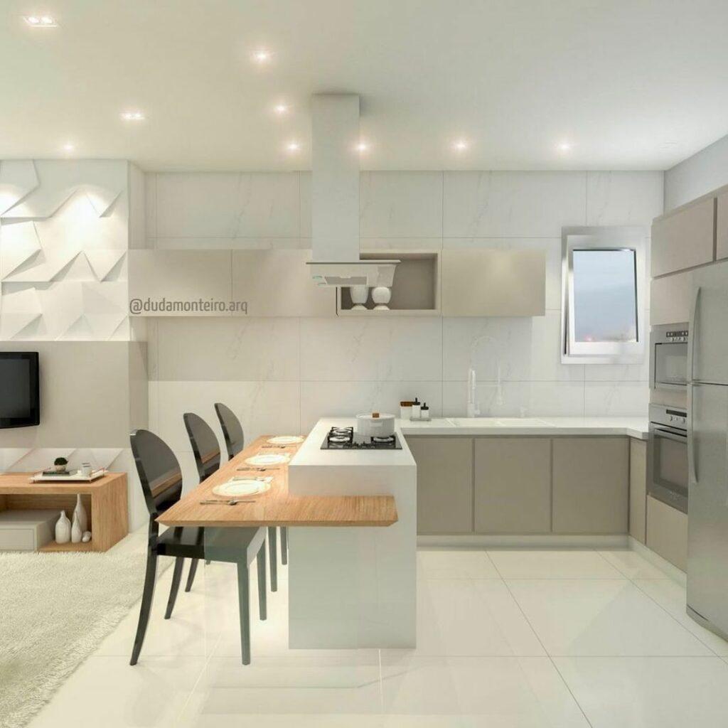 Cozinha americana com decoração semelhante entre cozinha e sala